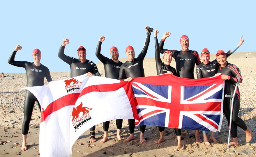 The team celebrating crossing the English Channel on French shores